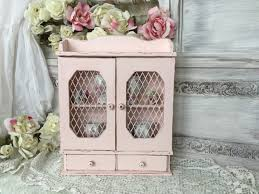 shabby chic pink hanging curio cabinet with wire mesh doors