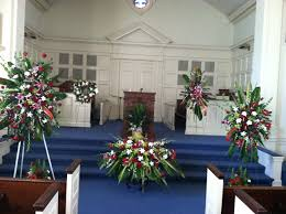 funeral flowers set up at first baptist church chapel before the