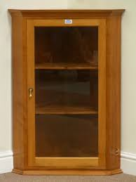 cherry wood corner cabinet cherry wood corner cabinet enclosed by single glazed door fitted two
