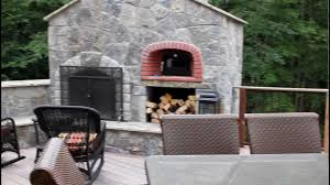 outdoor kitchen and stone fireplace with pizza oven built into