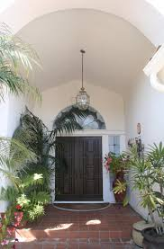 mediterranean home entry before and after san diego interior