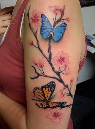 beautiful life like butterflies and flowers upper arms tattoo