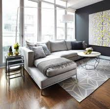 modern minimalist modern minimalist living room with hardwood floor and sectional
