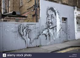 London Wall Murals Mural Street Art By Guy Denning Portrait Of Woman In White Scarf