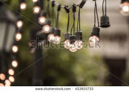 decorative outdoor string lights hanging on stock photo 436971544