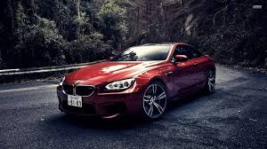 red bmw 2016 red bmw m6 on a mountain road 52107 1920 1080 cars wallpaper