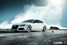 blue audi s7 white audi s7 quattro on vossen wheels fitted with blue brake
