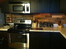 pallet backsplash in our old farm house kitchen highlighted by