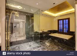 Spanish Bathroom Design by Glass Screen On Walk In Shower In Modern Spanish Bathroom With