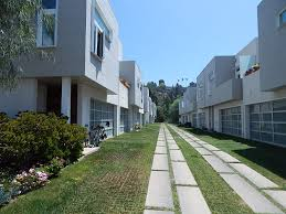 a modern townhouse complex with large plank pavers and grass crete