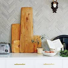 how to cut ceramic tile around kitchen cabinets out subway tile herringbone might be the coolest new