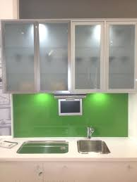 white kitchen cabinets doors glass laminate backwall silver