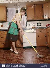 Kitchen Floor Cleaner by 1960s Woman In Apron Cleaning Kitchen Floor With Sponge Mop Stock