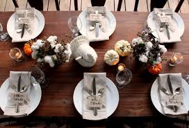 a thanksgiving table on the porch fall decorations
