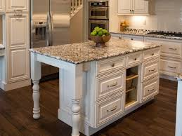 intriguing granite top kitchen island design presenting birch wood
