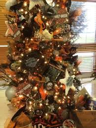 christmas tree decorated with harley davidson ornaments its not