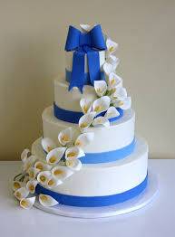 wedding cake with calla lily cascade by cakesuite serving
