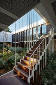 Home Courtyard by Prefabricated Home Surrounds Sloped Courtyard With 17th Century