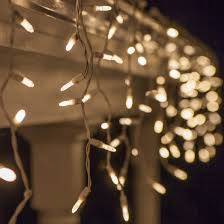twinkling white led icicle lights 70 m5 led icicle lights warm white twinkle white wire yard envy