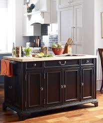 large rolling kitchen island large rolling kitchen island black tile backsplash light wood dining