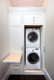 ironing board closet cabinet pull out ironing board transitional laundry room marsh and clark