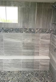 bathroom floor stone pebble tiles pinteres gray stone look large format wall tile with pebble mosaic accent and shower floor master
