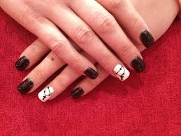 simple acrylic nail art design with black and white gel polish