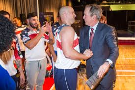 president bush shaking hands with invictus games athlete