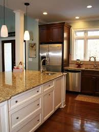 photo page hgtv traditional kitchen with large white island and dark wood wall cabinets