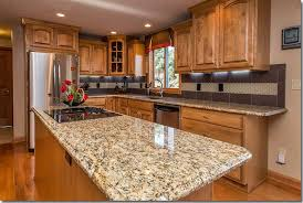 giallo fiorito granite with oak cabinets giallo ornamental granite countertops pictures cost pros and cons