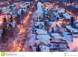 houses and streets in a winter night royalty free stock
