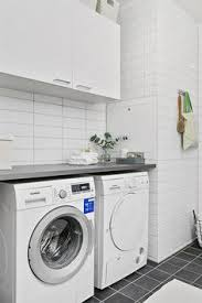 Laundry Room Pictures To Hang - white laundry room carrara marble hang bar sink spec house