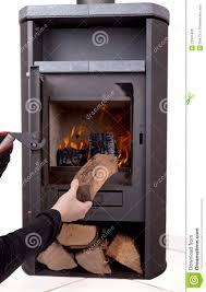 hand firing modern wood burning stove stock photos image 22847493