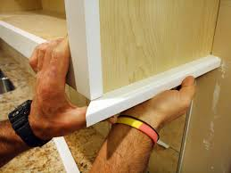 mounting kitchen cabinets how to install a kitchen cabinet light rail how tos diy