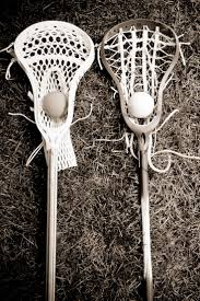 93 best lacrosse images on pinterest lacrosse lacrosse sticks two lacrosse heads and sticks with ball on grass black and white