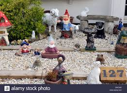 garden ornaments and gnomes in front garden stock photo royalty