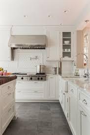 Creamy White Kitchen Cabinets Creamy White Cabinets Paired With Supreme White Quartzite