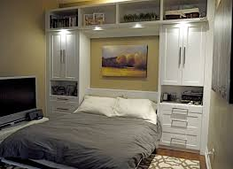elegance modern murphy bed with grey quilt and white tv table also
