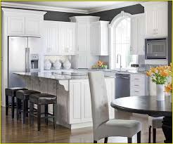 ivory kitchen cabinets what color walls home design ideas
