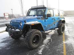 teal jeep rubicon lifted jeep wrangler edition rocky ridge trucks