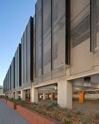 photograph of the perforated metal panel screen system at stanford in zahner began working on a third project with wrns studio a parking structure for stanford university in california its hoover garage structure