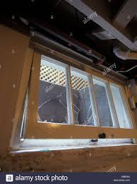 broken frame of open basement window in house stock photo royalty