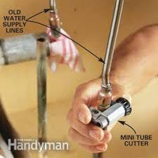 how to change the kitchen faucet how to replace a kitchen faucet family handyman