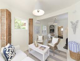 small cottage with coastal white interiors home bunch