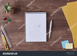 writing paper with space for picture office desk table blank notebook paper stock photo 455605168 office desk table with a blank notebook paper ruler pen envelope