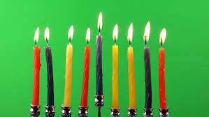hanukkah candles colors ten multi colored birthday candles in white icing in front of a
