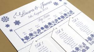 snowflake table top decorations i m dreaming of a white wedding with every snowflake name card i write