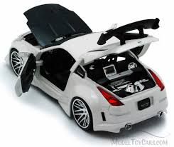 white nissan car nissan 350z white jada toys bigtime kustoms 92354 1 24 scale