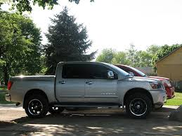 nissan titan with rims 20x9 black axis titans with 33x12 5x20 nitto terra grapplers