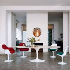 saarinen oval dining table by knoll yliving lifestyle paired with tulip armchair and tulip armless chair